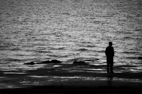 man on the shore of the sea